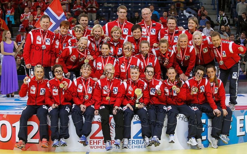 BELGRADE, SERBIA - DECEMBER 16: Norway handball team players posing on the podium after taking the second place during the Women's European Handball Championship 2012 medal ceremony at Arena Hall on December 16, 2012 in Belgrade, Serbia. (Photo by Srdjan Stevanovic/Getty Images)