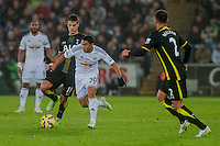Sunday  14th   December 2014 <br /> Pictured: Jefferson Montero of Swansea City makes his way past (Erik Lamela of Tottenham Hotspur  and Kyle Walker of Tottenham Hotspur <br /> Re: Barclays Premier League Swansea City v Tottenham Hotspur  at the Liberty Stadium, Swansea, Wales,UK