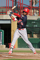 Peoria Chiefs Eliezer Alvarez (15) swings during the Midwest League game against the Burlington Bees at Community Field on June 8, 2016 in Burlington, Iowa.  Burlington won 4-2.  (Dennis Hubbard/Four Seam Images)