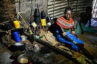 KENYA Marsabit, Samburu pastoral tribe, portrait of woman with traditional necklace in her kitchen / KENIA, Marsabit, Samburu Dorf Hargura, Portraet einer Samburu Frau mit traditionellem Halsschmuck in ihrer Kueche