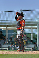 Baltimore Orioles catcher Christopher Burgess (54) during a Minor League Spring Training game against the Pittsburgh Pirates on April 21, 2021 at Pirate City in Bradenton, Florida.  (Mike Janes/Four Seam Images)