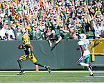 Green Bay Packers receiver Greg Jennings, left, makes a long first quarter touchdown catch ahead of Miami Dolphins' Vontae Davis at Lambeau Field in Green Bay, Wis., on Oct. 17, 2010.