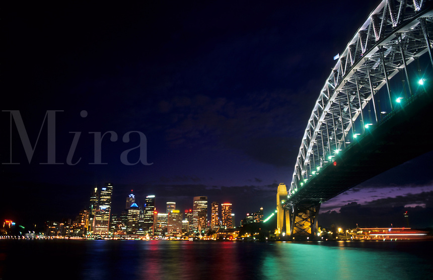 Grand harbour at night with Bridge and the city of Sydney, Australia.