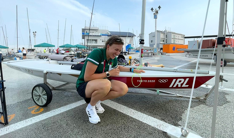 Annalise Murphy looks pleased in the Enoshima dinghy park with her competition supplied Laser Radial for the Tokyo 2020 Olympic Regatta