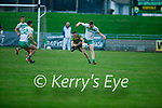 Gneeveguilla's Sean O'Keeffe attempts to block Mike Gogarty of Ballydonoghue's clearance in the 2020 County Junior Premier football final