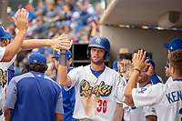 Rancho Cucamonga Quakes Cody Thomas (30) gets high-fives from his teammates after hitting a home run during the game against the Visalia Rawhide at LoanMart Field on May 13, 2018 in Rancho Cucamonga, California. The Quakes defeated the Rawhide 3-2.  (Donn Parris/Four Seam Images)