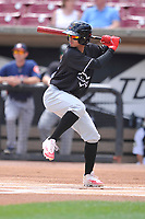 Quad Cities River Bandits shortstop Jonathan Arauz (22) swings during a game against the Wisconsin Timber Rattlers at Fox Cities Stadium on June 27, 2017 in Appleton, Wisconsin.  Wisconsin lost 6-5.  (Dennis Hubbard/Four Seam Images)