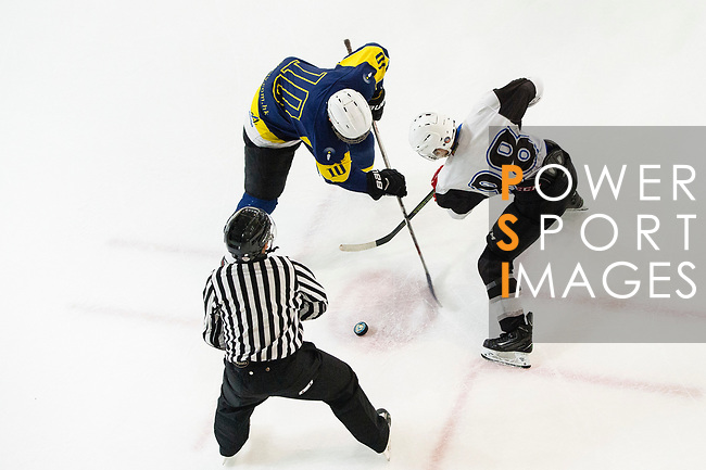 Verity Skater #10 Art Tam (left) fights for the puck with Gaggia Empire Skater #88 Hugo Fan (right) during the match Gaggia Empire vs Verity, a match part of the Principal Standard League on 07 March 2017 in Mega Ice, Hong Kong, China. Photo by Marcio Rodrigo Machado / Power Sport Images