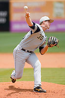 Relief pitcher Buck Farmer #30 of the Georgia Tech Yellow Jackets in action against the North Carolina State Wolfpack at the 2010 ACC Baseball Tournament at NewBridge Bank Park May 29, 2010, in Greensboro, North Carolina.  The Yellow Jackets defeated the Wolfpack 17-5.  Photo by Brian Westerholt / Four Seam Images