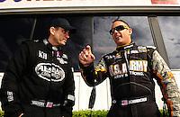 Nov. 13, 2011; Pomona, CA, USA; NHRA top fuel dragster driver Larry Dixon (left) with Tony Schumacher during the Auto Club Finals at Auto Club Raceway at Pomona. Mandatory Credit: Mark J. Rebilas-.