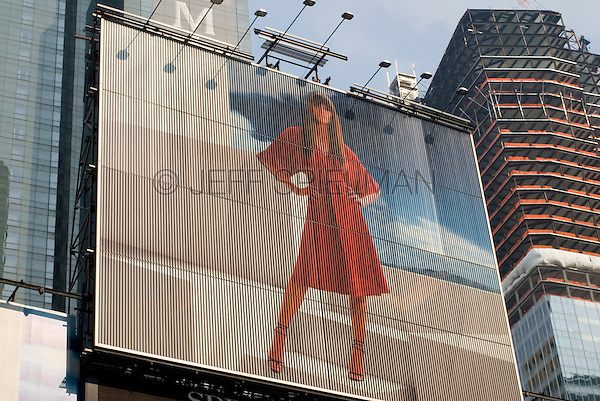 AVAILABLE FROM JEFF AS A FINE ART PRINT.<br /> <br /> AVAILABLE FROM JEFF FOR EDITORIAL LICENSING ONLY INSIDE A PUBLICATION.....NOT AVAILABLE FOR COMMERCIAL/ADVERTISING LICENSING BECAUSE THE IMAGE IS NOT MODEL OR PROPERTY RELEASED<br /> <br /> Upward View of Fashion Advertising Billboard in Times Square, New York City, New York State, USA....EDITORIAL USE ONLY - NOT RELEASED