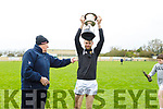 Kilmoyley captain John B O'Halloran holds aloft   the cup having defeated Causeway in the North Kerry Senior Hurling Championship final
