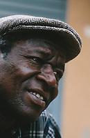 "Mali. Bamako. The musician Boubacar Traore ""Karkar"" in his home courtyard. © 1997 Didier Ruef"