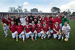 FC United of Manchester 0 Benfica 1, 29/05/2015. Broadhurst Park, Stadium Opening. Homeplayers posing for a team photograph at Broadhurst Park, Manchester, the new home of FC United of Manchester before the club's match against Benfica, champions of Portugal, which marked the official opening of their new stadium. FC United Manchester were formed in 2005 by fans disillusioned by the takeover of Manchester United by the Glazer family from America. The club gained several promotions and played in National League North in the 2015-16 season, but lost this match 1-0. Photo by Colin McPherson.