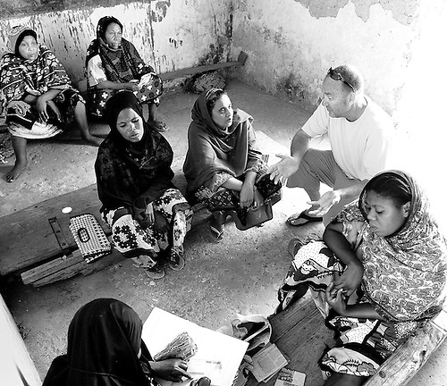 Louis Pope, founder of Yehu micro finance in Kenya speaks to women at a local meeting.  Yehu is a microfinance organization in the rural coastal region of Kenya for the poor, run by the poor. It provides financial and other support services for small businesses owned by very poor people.
