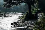 """November 10, 2014. """"Water it´s the real thing""""<br /> A bullock cart is in the river Acelhuate (Nejapa, El Salvador) to take water. The river is contaminated. .The people of Nejapa in El Salvador, have no drinking water because the Coca -Cola company overexploited the aquifer in the area, the most important source of water in this Central American country. This means that the population has to walk for hours to get water from wells and rivers. The problem is that these rivers and wells are contaminated by discharges that makes Coca- Cola and other factories that are installed in the area. The problem can increase: Coca Cola company has expansion plans, something that communities and NGOs want to stop. To make a liter of Coca Cola are needed 2,4 liters of water.  ©Calamar2/ Pedro ARMESTRE"""