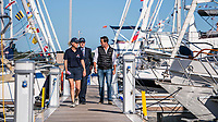 BNPS.co.uk (01202 558833)<br /> Pic: MaxWillcock/BNPS<br /> <br /> Pictured: The Honourable Mary Montagu-Scott, The Right Honourable The Lord Montagu of Beaulieu and Sir Ben Ainslie walk down a pontoon.<br /> <br /> Britain's most decorated Olympic sailor Sir Ben Ainslie is the guest of honour at a celebration for the 50th anniversary and completion of the £2m redevelopment of Buckler's Hard Yacht Harbour in Beaulieu, Hampshire.