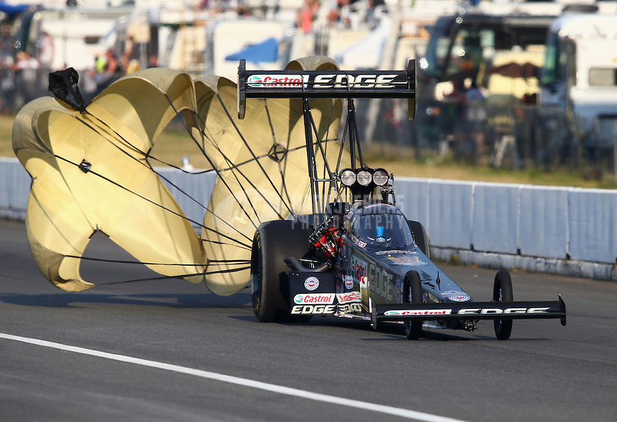 Aug. 1, 2014; Kent, WA, USA; NHRA top fuel dragster driver Brittany Force during qualifying for the Northwest Nationals at Pacific Raceways. Mandatory Credit: Mark J. Rebilas-