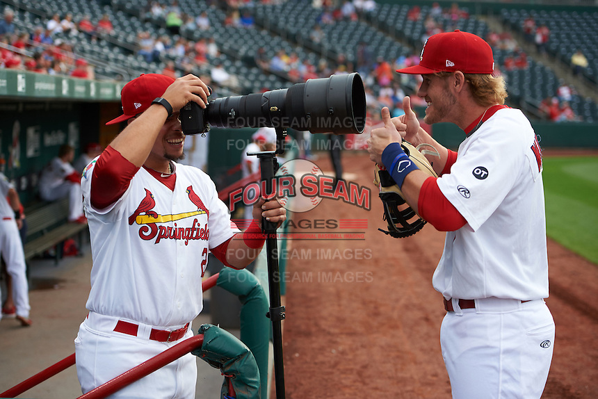 Springfield Cardinals Patrick Wisdom (5) jokingly poses for Jonathan Rodriguez (28) using a Nikon D4s and 400mm 2.8 lens before a game against the Frisco RoughRiders  on June 3, 2015 at Hammons Field in Springfield, Missouri.  Springfield defeated Frisco 7-2.  (Mike Janes/Four Seam Images)