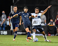 LAKE BUENA VISTA, FL - JULY 26: Ilie Sánchez of Sporting KC battles Theo Bair of Vancouver Whitecaps FC for the ball during a game between Vancouver Whitecaps and Sporting Kansas City at ESPN Wide World of Sports on July 26, 2020 in Lake Buena Vista, Florida.