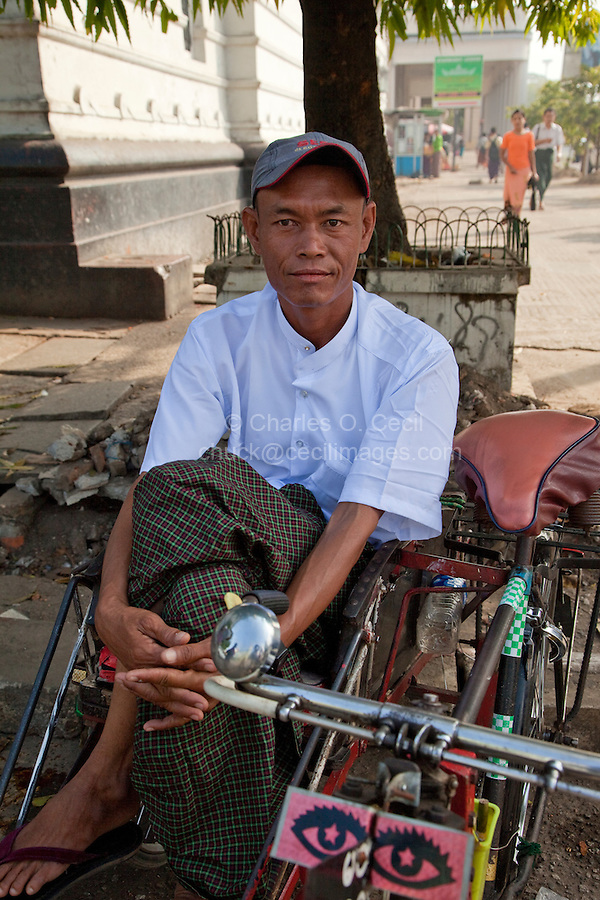Myanmar, Burma, Yangon.  Bicycle Rickshaw Driver.