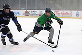 Notre Dame Fighting Irish of Batavia forward Peter Madaferri (27) skates up ice ahead of Josh Hettinger (19) during a varsity ice hockey game against the Brockport Blue Devils during the Section V Rivalry portion of the Frozen Frontier outdoor hockey event at Frontier Field on December 22, 2013 in Rochester, New York.  (Copyright Mike Janes Photography)