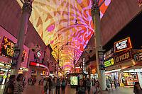 Las Vegas, Nevada.  Fremont Street Experience.  Four Zipline Riders above.