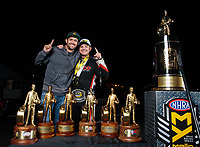 Nov 11, 2018; Pomona, CA, USA; NHRA top fuel driver Steve Torrence poses for a portrait with photographer Mark Rebilas as he celebrates after winning the Auto Club Finals at Auto Club Raceway. Torrence swept all six of the countdown to the championship races to clinch the world championship. Mandatory Credit: Jason Zindroski