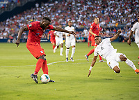 KANSAS CITY, KS - JUNE 26: Kevin Galvan #6 attempts to block a shot by Jozy Altidore #17 during a game between Panama and USMNT at Children's Mercy Park on June 26, 2019 in Kansas City, Kansas.