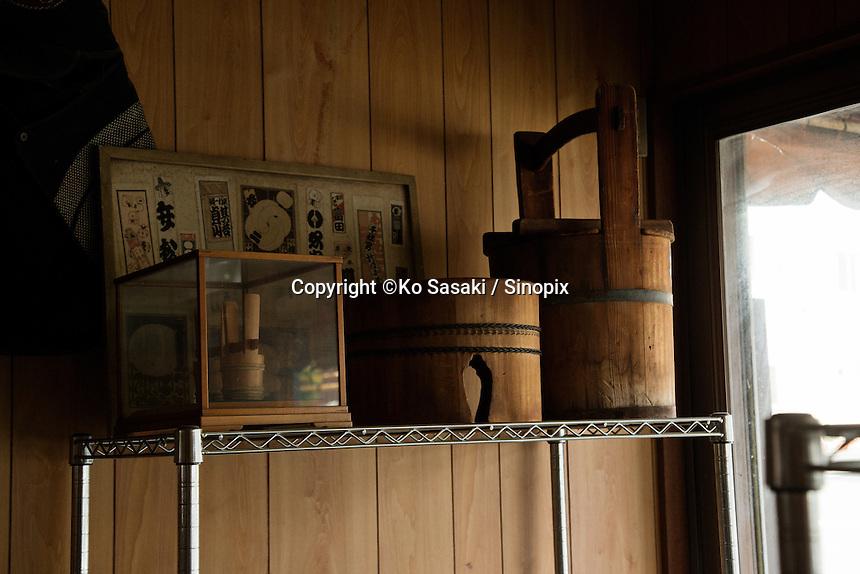 Wooden buckets on the shelf at Eifu Kawamata's Okeei atelier.