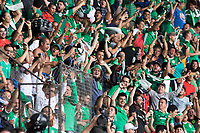 MEXICO CITY, MEXICO - June 11, 2017:  Mexico fans cheer after their team scores a goal. They also jeer USA fans attending the World Cup Qualifier match against Mexico at Azteca Stadium.