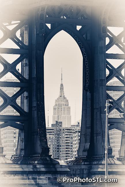 Empire State Building seen through Manhattan Bridge between Brooklyn and Manhattan in New York City.