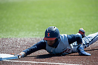 Illinois Fighting Illini outfielder Taylor Jackson (15) dives back to first base during the NCAA baseball game against the Michigan Wolverines on March 20, 2021 at Fisher Stadium in Ann Arbor, Michigan. Michigan won the game 8-1. (Andrew Woolley/Four Seam Images)