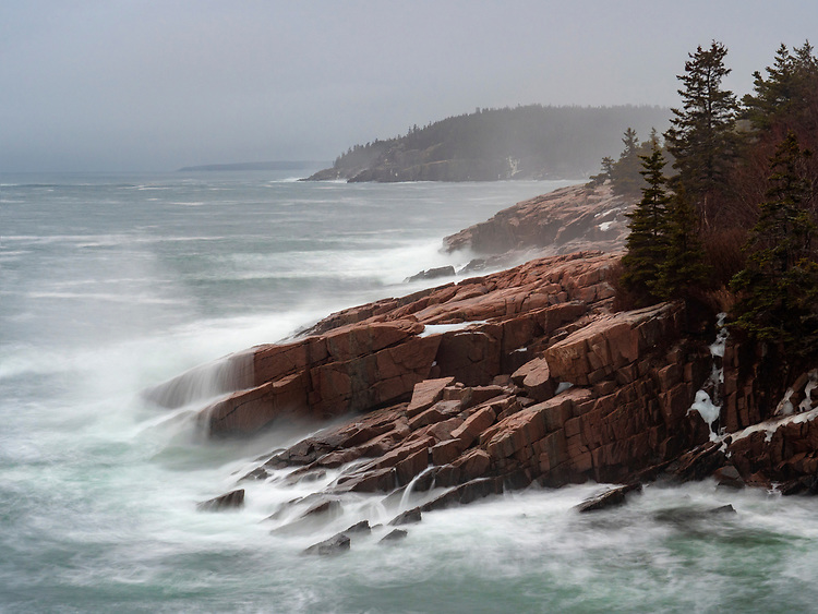 Long-exposure of waves meeting the rocky granite coastline on a foggy day along Ocean Drive/Park Loop Road on Mount Desert Island in Acadia National Park, Maine