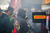 Sep 14, 2019; Mohnton, PA, USA; NHRA fans in the pits wear gas masks as cars warm up during qualifying for the Reading Nationals at Maple Grove Raceway. Mandatory Credit: Mark J. Rebilas-USA TODAY Sports