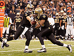 December 2009: New Orleans Saints quarterback Drew Brees (9) hands the ball of to running back Pierre Thomas, right, during an NFL football game at the Louisiana Superdome in New Orleans.  The Cowboys defeated the Saints 24-17.
