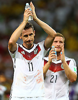 Miroslav Klose of Germany applauds the fans at full time