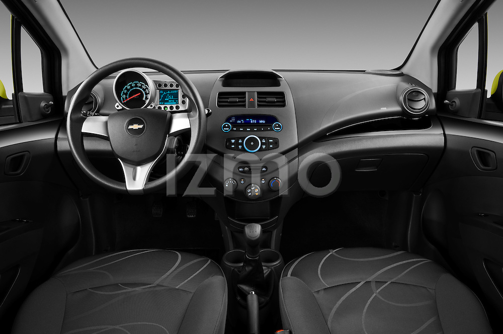 Straight dashboard view of a 2011 Chevrolet Spark LS 5 Door Hatchback .