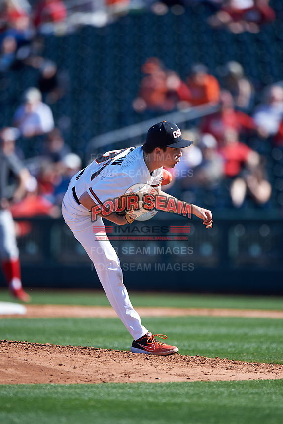 Oregon State Beavers starting pitcher Christian Chamberlain (34) delivers a pitch during an NCAA game against the New Mexico Lobos at Surprise Stadium on February 14, 2020 in Surprise, Arizona. (Zachary Lucy / Four Seam Images)