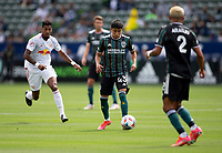 CARSON, CA - APRIL 25: Adam Saldaña #43 of the Los Angeles Galaxy moves with the ball during a game between New York Red Bulls and Los Angeles Galaxy at Dignity Health Sports Park on April 25, 2021 in Carson, California.
