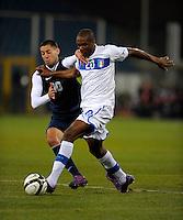 GENOVA, ITALY - February 29, 2012: Clint Dempsey (l, USA), Angelo Obinze Ogbonna (r, ITA) during the USA friendly match against Italy at the Stadium Luigi Ferraris in Genova, Italy.