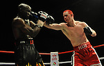 Hari Miles ( Red with Black stripe ) V Nick Okoth (Black flame shorts). , Joe Calzaghe Promotions Boxing Evening .Date: Friday 20/11/2009,  .© Ian Cook IJC Photography, 07599826381, iancook@ijcphotography.co.uk,  www.ijcphotography.co.uk, .