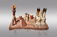 Ancient Egyptian wooden model of bread making, Middle Kingdom, 12th Dynasty, (1939-1875 BC), Asyut., Tomb of Minhotep Egyptian Museum, Turin. Cat 8789. Grey background. <br /> <br /> Wooden tomb models were an Egyptian funerary custom throughout the Middle Kingdom in which wooden figurines and sets were constructed to be placed in the tombs of Egyptian royalty. These wooden models represented the work of servants, farmers, other skilled craftsman, armies, and religious rituals