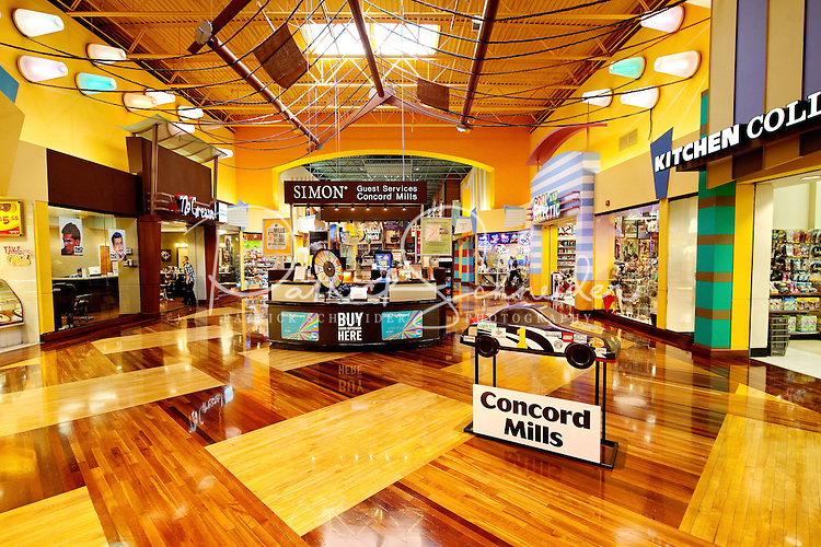 Wide-angle photography inside Concord Mills Mall, a 1.4 million-square-foot mall located in Concord, NC, about 12 miles from Charlotte, NC. Concord Mills is located about a mile from Charlotte Motor Speedway. It attracts tens of millions of visitors each year. Photo is part of a photographic series of images featuring Concord, NC, by photographer Patrick Schneider.