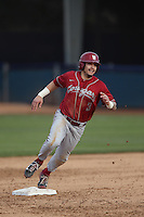 Trace Tam Sing #3 of the Washington State Cougars  runs the bases during a game against the Cal State Fullerton Titans at Goodwin Field on  February 15, 2014 in Fullerton, California. Washington State defeated Fullerton, 9-7. (Larry Goren/Four Seam Images)
