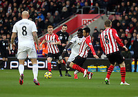 Pictured: Bafetimbi Gomis against Maya Yoshida of Southampton Sunday 01 February 2015<br />