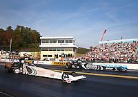 Oct 6, 2013; Mohnton, PA, USA; NHRA top fuel dragster driver Doug Kalitta (near lane) races alongside Shawn Langdon during the Auto Plus Nationals at Maple Grove Raceway. Mandatory Credit: Mark J. Rebilas-