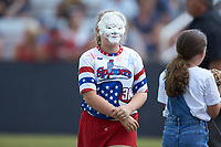 A young fan has a face full of whipped cream after losing an on-field contest between innings of the game between the Statesville Owls and the Mooresville Spinners at Moor Park on June 14, 2020 in Mooresville, NC.  The Owls defeated the Spinners 8-7 in 10 innings. (Brian Westerholt/Four Seam Images)