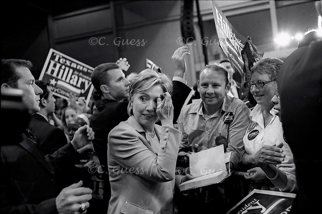Senator Hillary Clinton takes a quick break while signing autographs after a speech in Dallas, Texas before the Texas primaries.