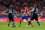 Atletico de Madrid's Diego Costa and Club Brugge's Mats Rits (L) and Ruud Vormer (R) during UEFA Champions League match between Atletico de Madrid and Club Brugge at Wanda Metropolitano Stadium in Madrid, Spain. October 03, 2018. (ALTERPHOTOS/A. Perez Meca)